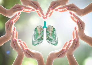 Healthy lung shape world design logo concept idea with love heart shape symbolic sign of women human hands on blur green natural clean air greenery background: Element of this image furnished by NASA